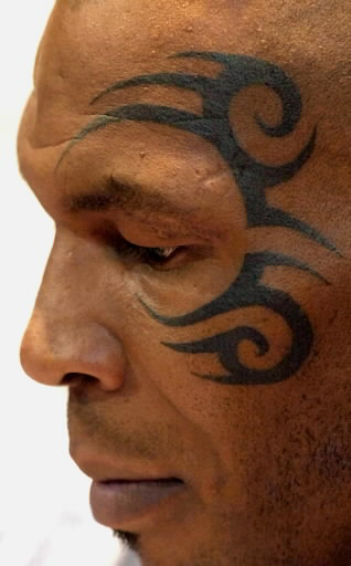 mike tyson s tattoo what the the story behind the faces. Black Bedroom Furniture Sets. Home Design Ideas